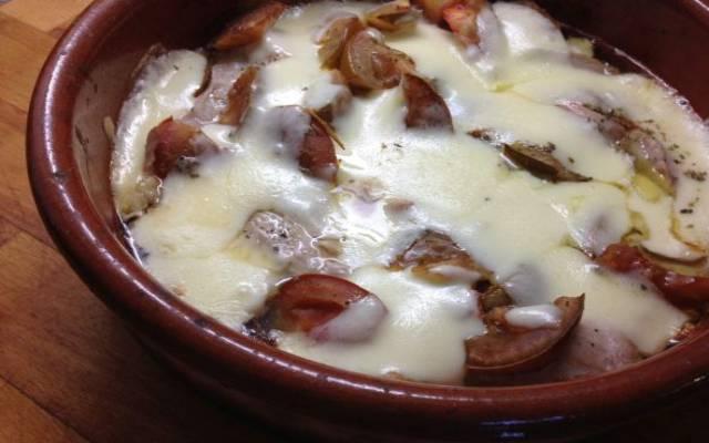 Secreto de cerdo al horno con queso
